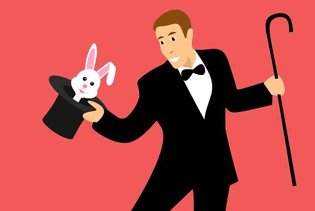 kouzelník vytahuje králíka z klobouku